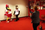Rachel Brady, Cardinals Communications Department, with Fredbird & the Rally Squirrel taking photos to be creatively inserted into historic images from the Cardinals Archives for the production of #BirdToTheFuture