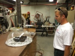 Barry Abbett, Cardinals Carpenter, inspects the power supply for Fredbird's Time Machine - - Lou Brock's shoes.