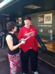 Melody Yount, Manager of Communications, with Red Schoendienst during the production of #BirdToTheFuture