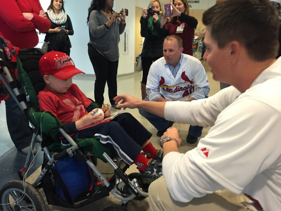 This kid's day was made when former Cardinal pitcher, Brad Thompson, let him try on the 2006 World Series Championship Ring!