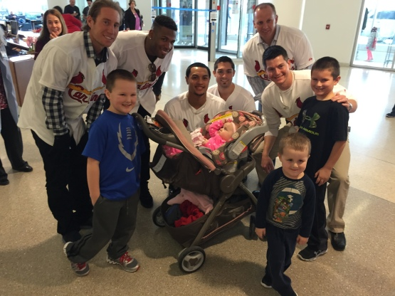 These big brothers were excited to be bringing their baby sister home....but they still had time to stop for a photo op with some players from their favorite baseball team!