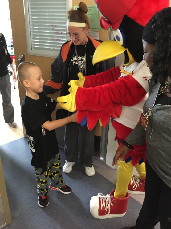 This guy just could not wait to get a hug from Fredbird.