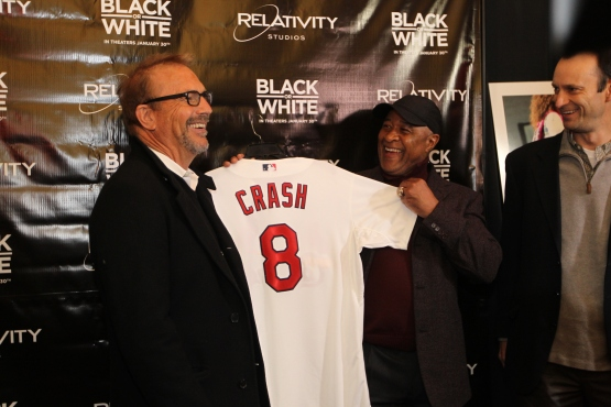 """Ted Savage, Ozzie Smith and Bill DeWitt III present Kevin Costner with a Cardinals Jersey with the name """"Crash"""" in honor of his character Crash Davis from the film Bull Durham while on the red carpet before the screening of Costner's latest film """"Black or White"""" at Ronnie's 20 Cine in South County"""