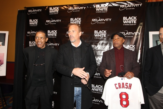 """Ted Savage, Ozzie Smith and Bill DeWitt III present Kevin Costner with a Cardinals Jersey with the name """"Crash"""" in honor of his character Crash Davis from the film Bull Durham"""