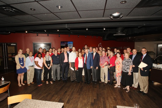 Members of the Cardinals front office pose for a photo with Commissioner Bud Selig in the UMB Champions Club at Busch Stadium on September 20, 2014