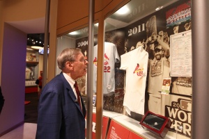 Commissioner Selig views the 2011 World Series Case featuring a remnant of David Freese's jersey on display within the Championship Gallery at the Cardinals Museum