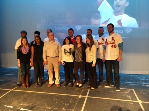 The Cardinals join the MSSU Communications students for a photo at the Taylor Performing Arts Auditorium