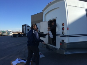 Nic, Justen and Vince verify that all luggage is accounted for on the new bus.
