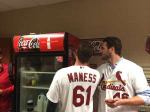 Kevin and Seth check out the photograph on the Springfield Cardinals magnet schedule.