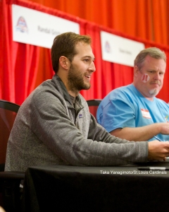 Michael Wacha signs with a smile.
