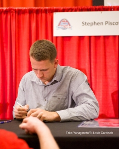 Stephen Piscotty signs.