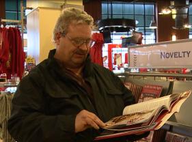 Cardinals Fan, Marc Coleman, flips through the pages of Redbird Relics book.